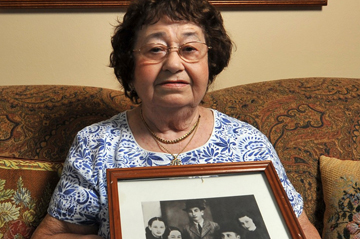 woman holding photo of family