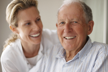 photo of smiling man with caregiver
