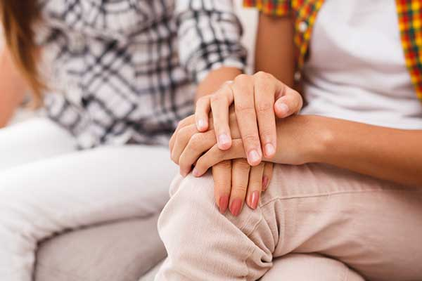 Photo of comforting hands