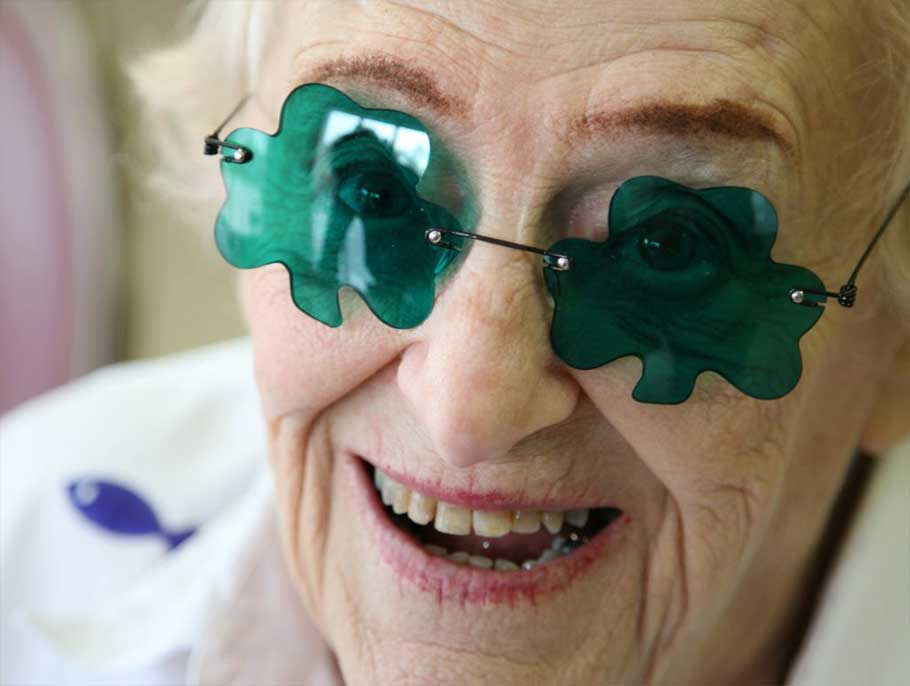 Photo of elderly woman, shamrock glasses
