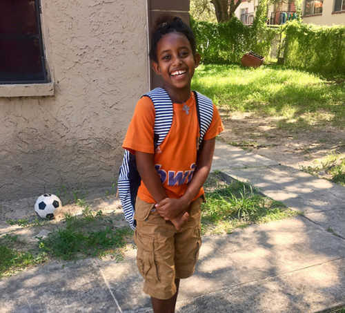 young boy happy with new backpack