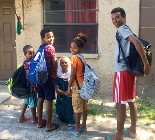 smiling family with new backpacks