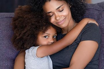 mom comforting daughter