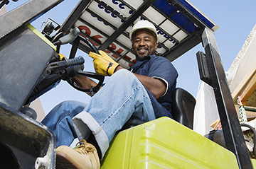 Photo of man driving forklift