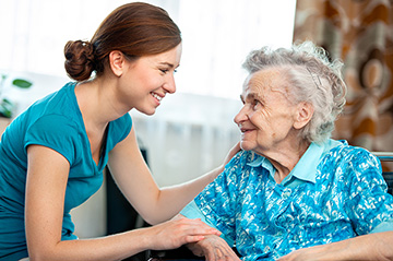 Photo of Senior woman with her caregiver at home