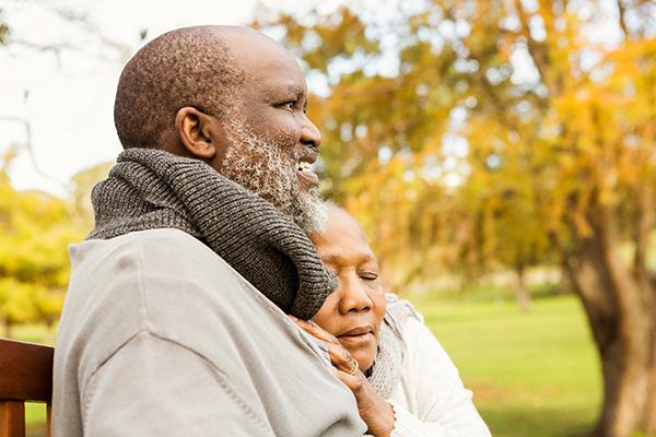 peaceful senior couple on park bench