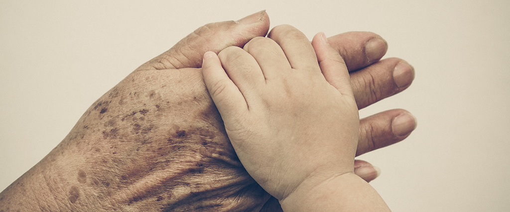A world made better…. Begin today! image of elder hand with child hand
